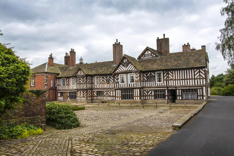 The Tudor Façade, extensive gardens and grounds of Adlington Hall in Cheshire. Adlington Hall is a country house near Adlington, Cheshire. The oldest part of royalty free stock photography
