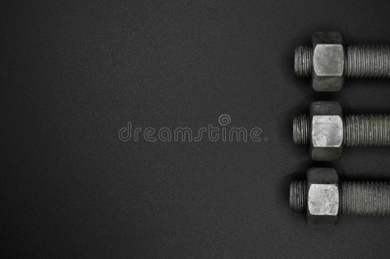 Tuercas de metales pesados, equipo de las herramientas foto de archivo libre de regalías