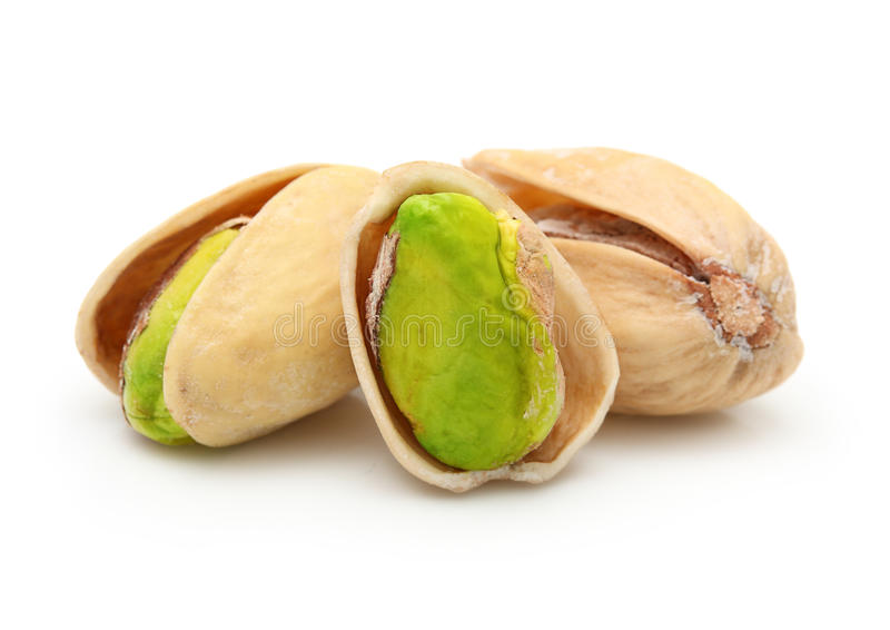 Tuercas de pistacho aisladas imagen de archivo
