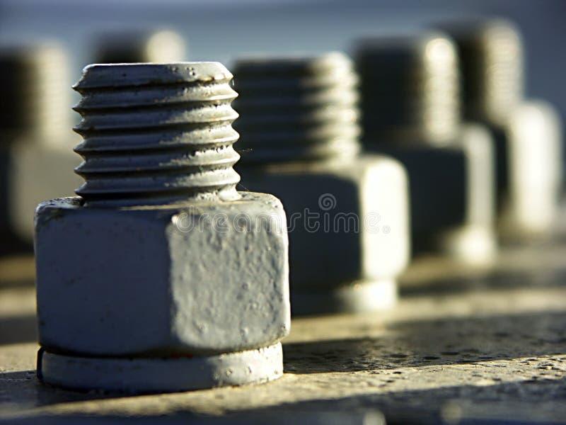 Tuercas - y - tornillos foto de archivo libre de regalías