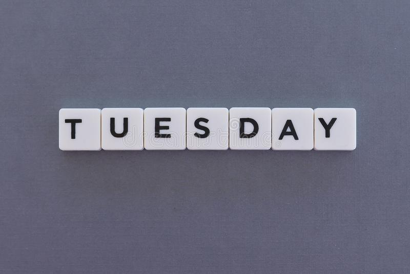 Tuesday word made of square letter word on grey background stock photo