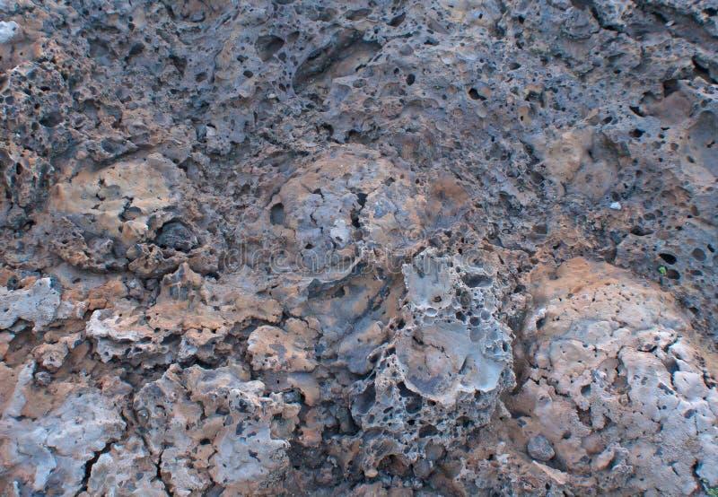 tufa утеса лавы предпосылки multicolor стоковое изображение