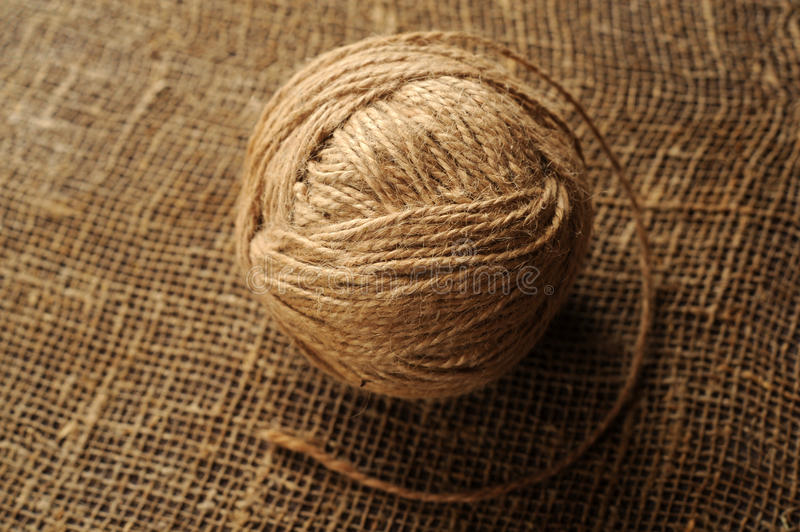A tuft of woolen threads for knitting and weaving. On a background of rough matting stock photos