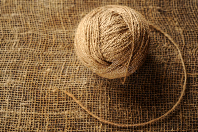 A tuft of woolen threads for knitting and weaving on a background. Of rough matting royalty free stock photography