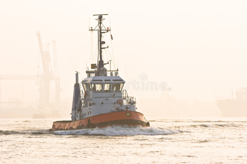 Tug. On the river on a misty sunrise in september stock photos