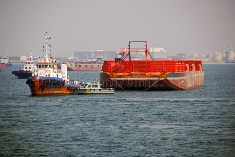 Tug and barge in Singapore anchorage. royalty free stock photo