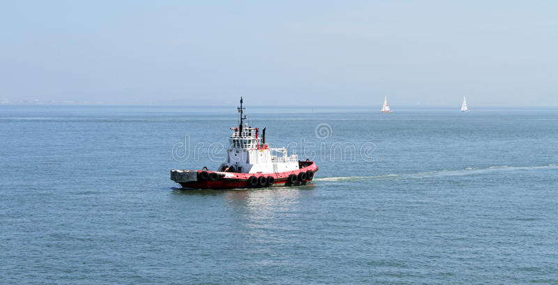 Tug Boat In The Middle Of Nowhere Stock Photo