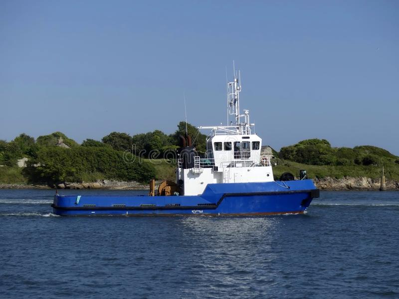 Tug boat in operations royalty free stock photo