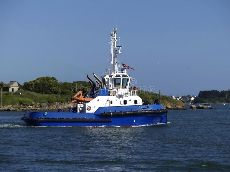 Tug boat in operations stock photography