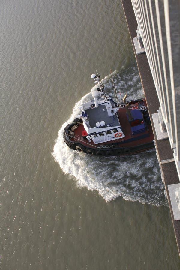 Download A Tug Boat Passes Beneath A Bridge Stock Image - Image: 20580511