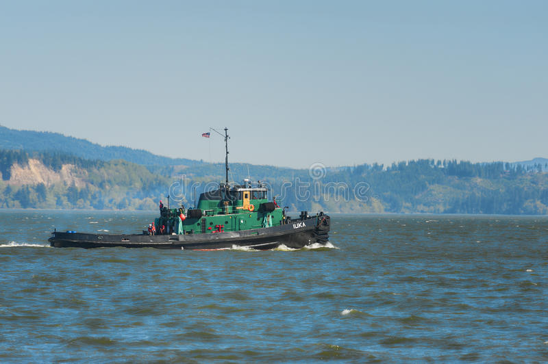 Tug Boat passes by on the Columbia River royalty free stock photos