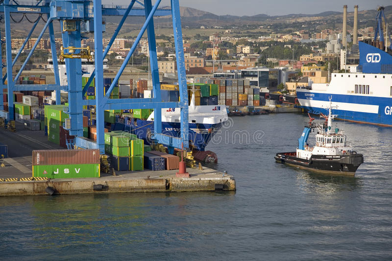 Tug boat pulling cargo ship to sea at port of - Getting from civitavecchia port to rome ...