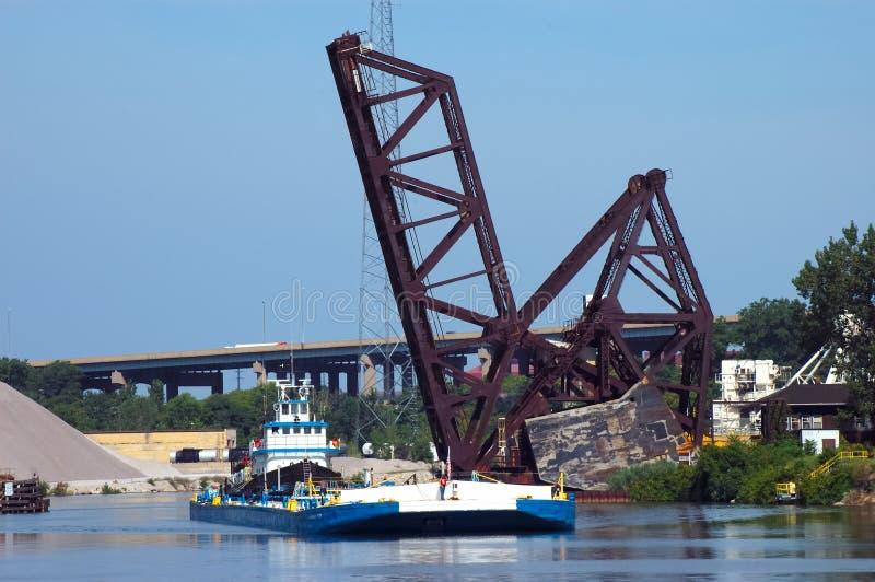 Tug Boat at RR Bridge royalty free stock photo