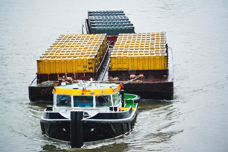Tug boat transporting containers