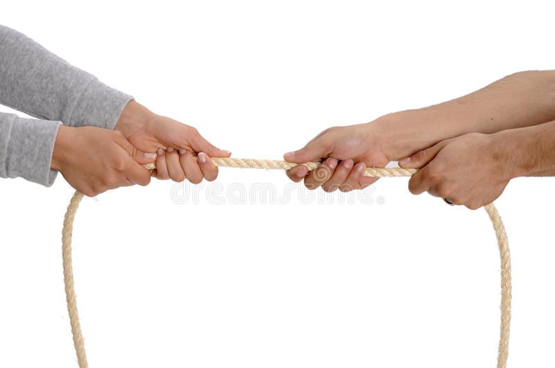 Tug of war. Close up on hands. duel and challenge concept royalty free stock photos