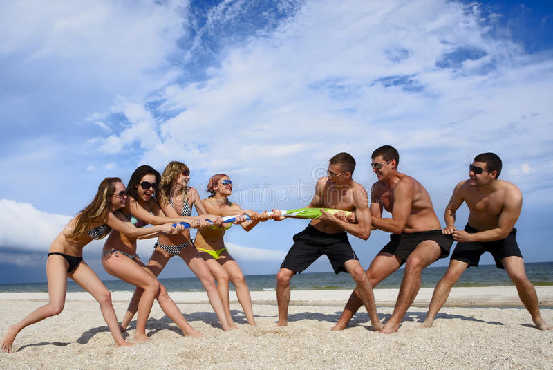 Download Tug-of-war on the beach stock photo. Image of friends - 15199112
