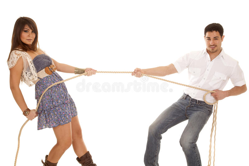Tug of war cowboy and cowgirl stock image