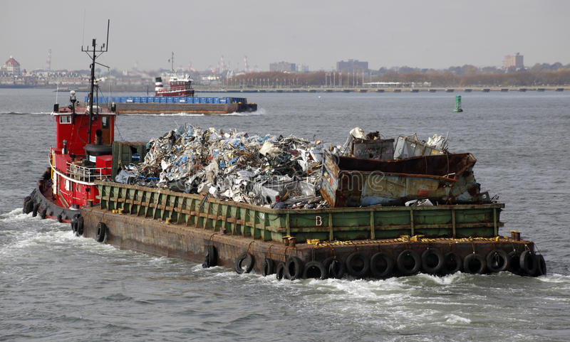 Tugboat. Guiding a garbage in New York City New York USA stock images
