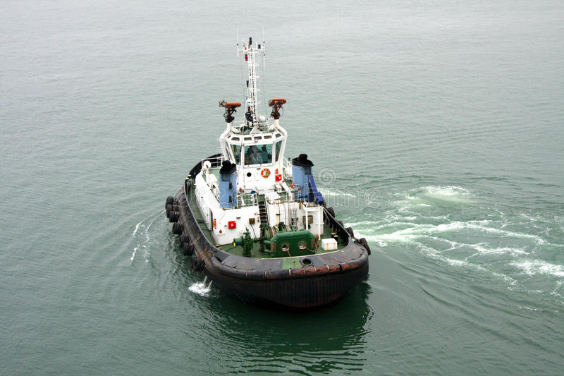 Tugboat. Frontal view of tugboat in harbour royalty free stock image