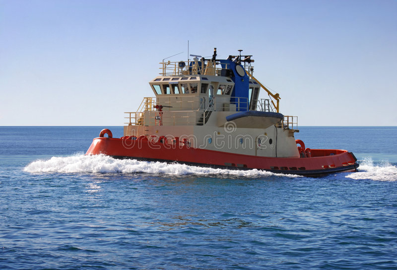 Tugboat. A tugboat out at sea royalty free stock photography