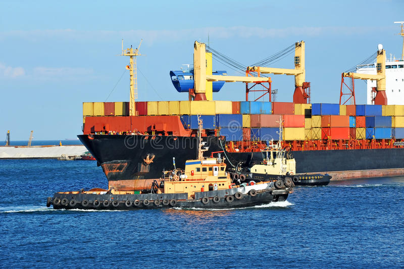 Download Tugboat Assisting Container Cargo Ship Stock Photo - Image: 43770426