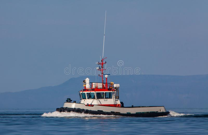 Tugboat. On calm Icelandic waters royalty free stock image