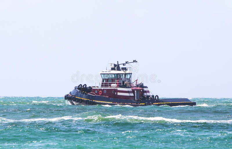 Tugboat. A tugboat cruising in the blue waters royalty free stock photography