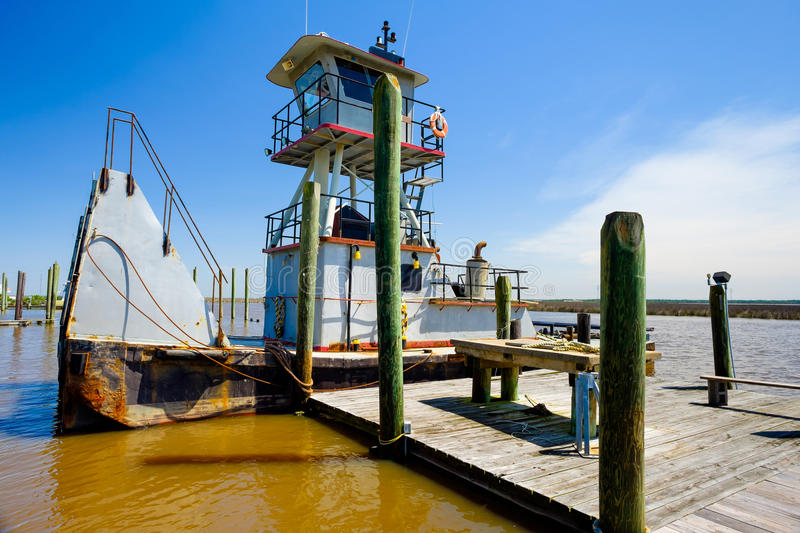 Tugboat. Docked along the shoreline in Mississippi stock photos