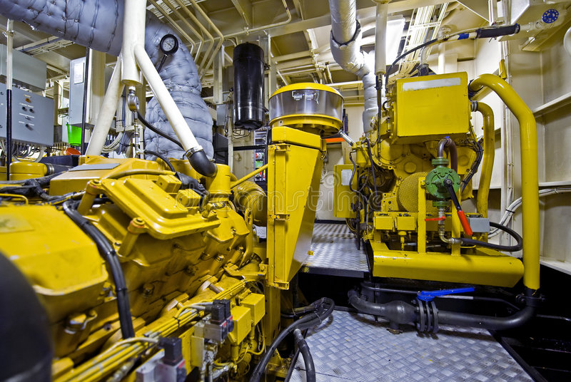 Tugboat engine room. The engine room of a tugboat, used for firefighting tasks stock photos