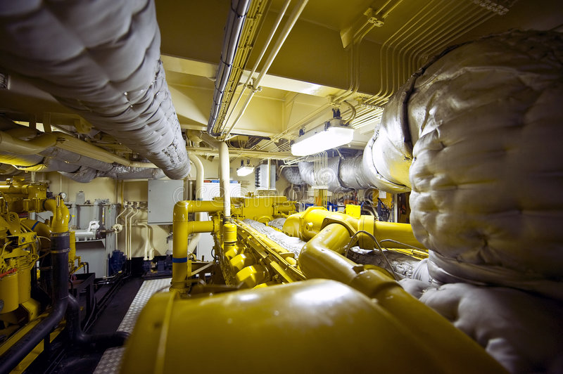 Tugboat Engine Room. The engine room of a tugboat with valves, vents, exhaust, pipes and plumbing royalty free stock photos