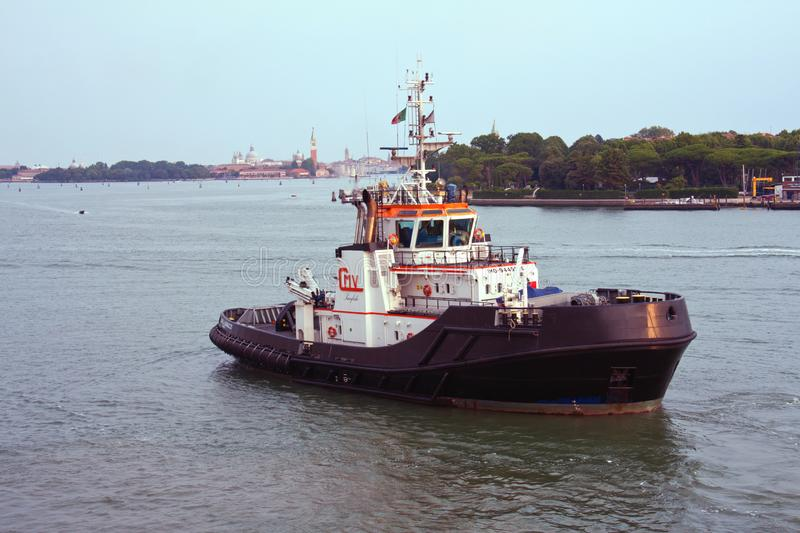 Tugboat in harbour stock images