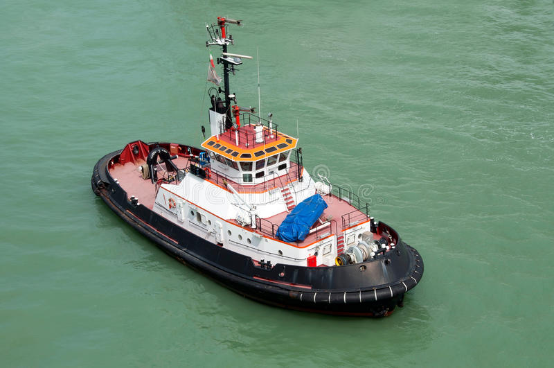 Tugboat. A modern tugboat waiting for a ship royalty free stock photo
