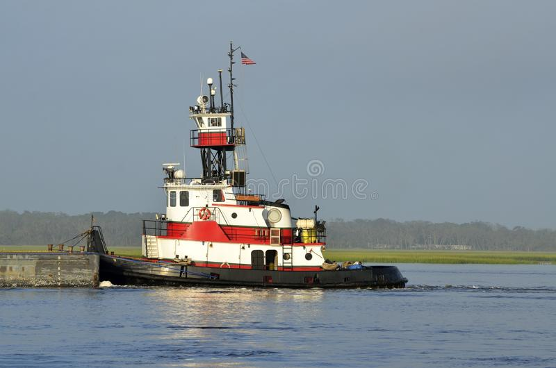 Tugboat Pushing A Barge. A tugboat pushing a barge on the river at St. Augustine, Florida royalty free stock photos