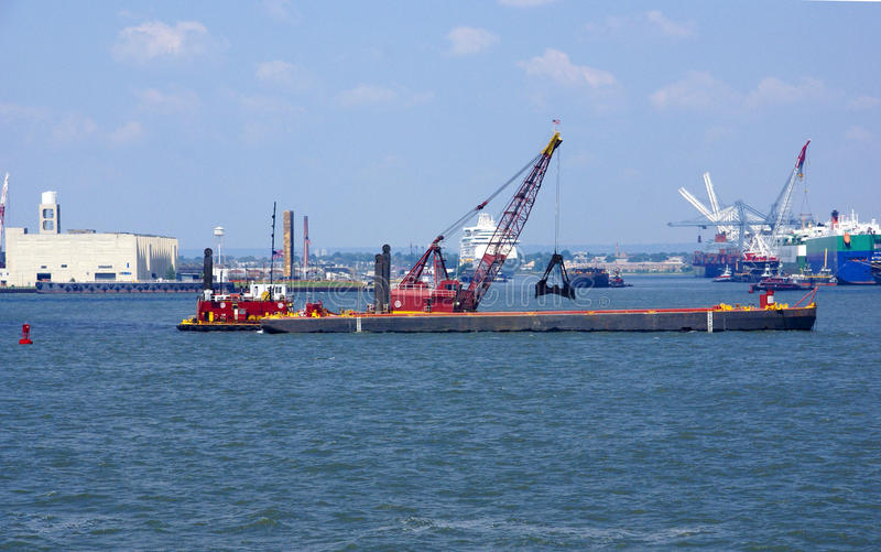 Tugboat pushing dredging barge. In New York Harbor,from Staten Island Ferry royalty free stock photos
