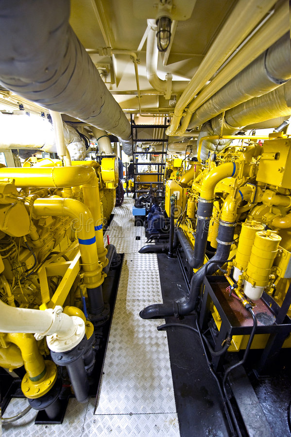 Tugboat's Engine Room. The engine room of a tugboat, with the various diesel engines for propulsion stock photo