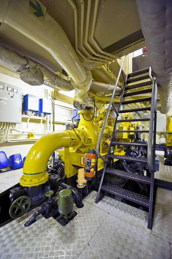 Tugboat's engine room. The engine room of a tugboat with its huge diesel engines stock photography