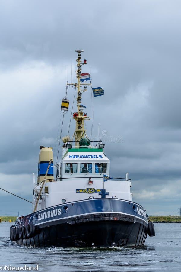 Tugboat Saturnus in operation. royalty free stock photos