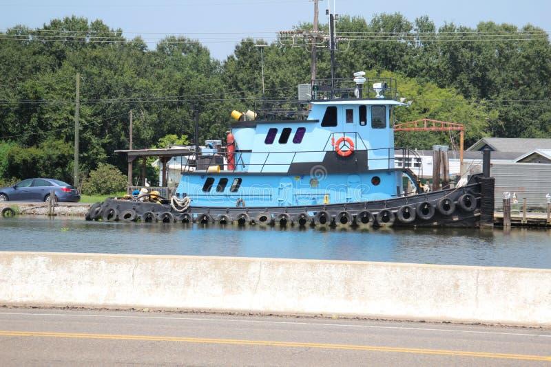 Louisiana Tugboat. A tugboat in South Louisiana stock photo