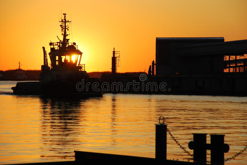 Tugboat at the sunset royalty free stock photos