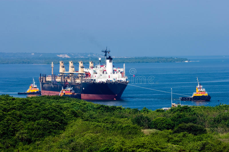 Tugboat towing a ship royalty free stock image
