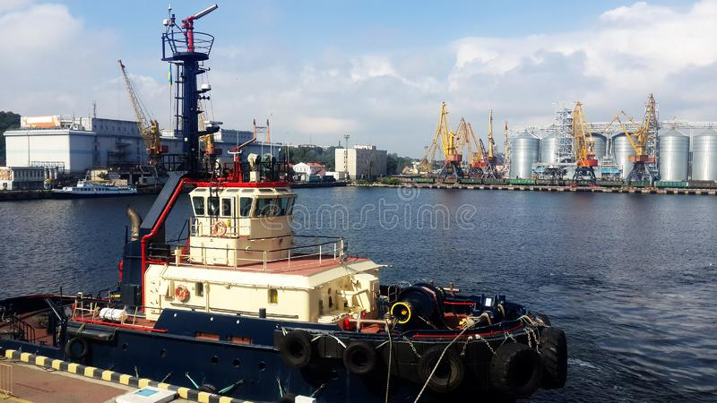 Tugboat in trading sea port royalty free stock photo