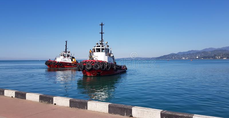 Tugboats awaiting ships. Batumi toilers of the port tugboats intended for towing and canting other vessels and floating structures are used on all types of royalty free stock photo