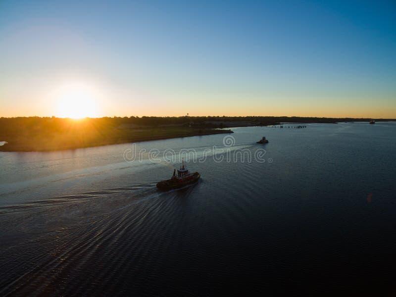 Tugboats at dawn stock photography