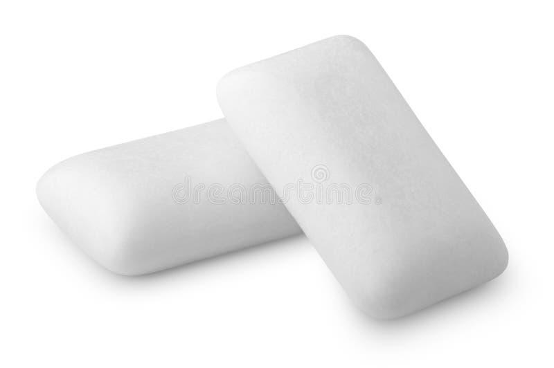 Tugga eller bubbelgummar på vit arkivfoto