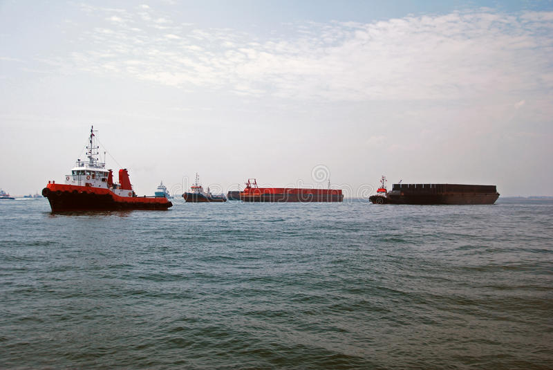 Tugs and barges in Singapore anchorage. stock photo