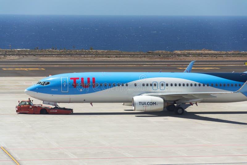 TUI Airway charter airline Boeing 737-800 airplane preparing for flight on airport. GRANADILLA DE ABONA, SPAIN - JULY 13 2019: TUI Airway charter airline Boeing stock photography