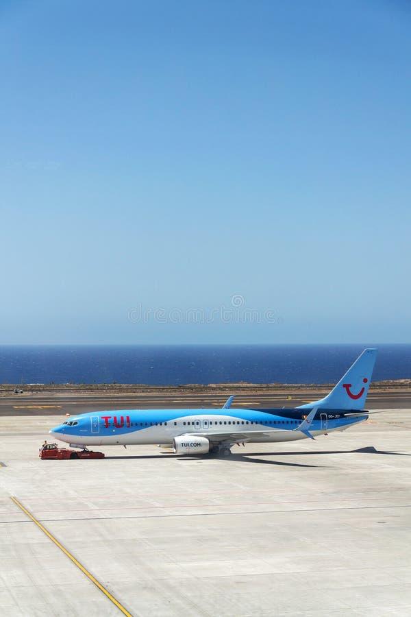 TUI Airway charter airline Boeing 737-800 airplane preparing for flight on airport. GRANADILLA DE ABONA, SPAIN - JULY 13 2019: TUI Airway charter airline Boeing royalty free stock photo