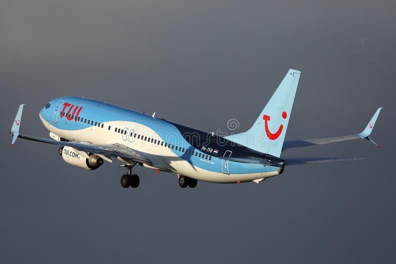 TUI Airways flying up in the dark sky. TUI Airways airplane flying to vacation destination royalty free stock photo