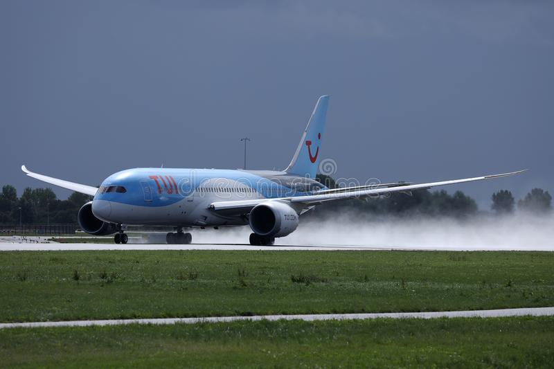 TUI Airways plane landing on airport, spectacular touchdown. TUI Airways airplane flying to vacation destination stock images