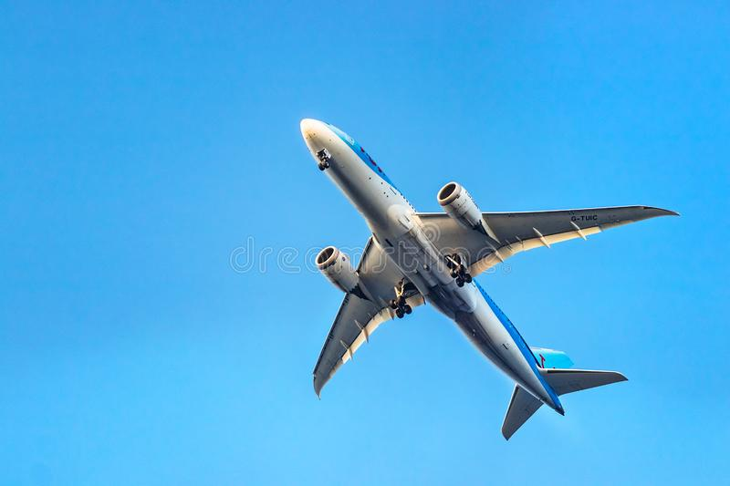 A TUI Airways Boeing 787-8 Dreamliner taking off below view at Rhodes, Greece stock image